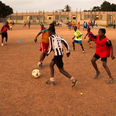 A sports player gains experience through volunteer football coaching in Ghana.